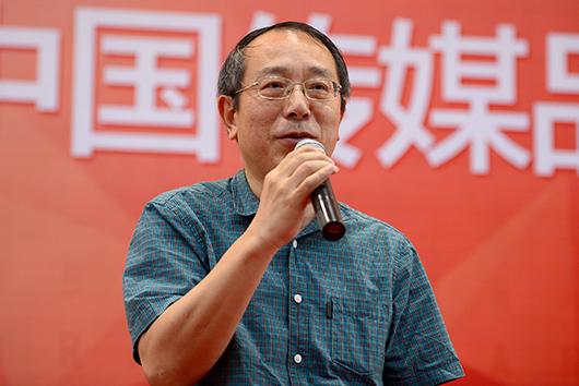 王伟/上海报业集团副社长王伟。
